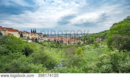 View Of Prague Castle Over Red Roof From Petrin Area In Summer, Prague, Czech Republic. Scenic View
