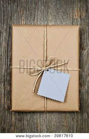 Gift With Tag In Brown Paper
