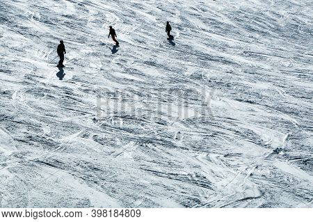 The Skiers On The Slope During The Sunny Day. The Nice Picture Of The Winter Ski Atmosphere. Skiers