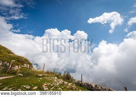 Beautiful Cumulus Clouds (cumulonimbus) On Blue Sky In Mountain, Monte Baldo, Mountain Range Between