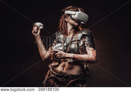 Portrait Of A Barbaric Woman From Nord Dressed In Medieval Armour Posing In Dark Background With Vir