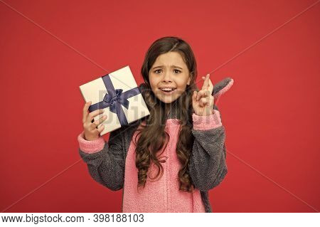 Mysterious Present. Happy Child Cross Fingers With Present. Little Girl Hold Present Box. Birthday P