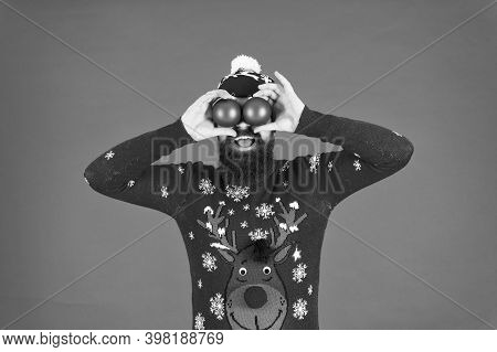 Look Through Prism Of Holiday. Santa Hold Christmas Ball Decoration. Christmas Toy Store. Man Decora