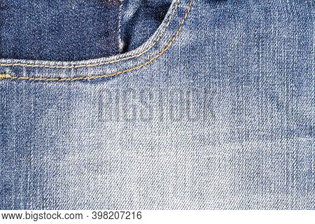 Light Blue Jeans Fabric With Side Pocket Background. Jeans Detail. Blue Jeans Texture Background.
