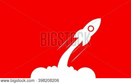 White Rocket Launch Isolated On Red Background. Minimalistic Background Design. Startup Launch Rocke