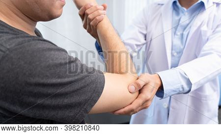 Physiotherapist Working Concept, Doctor And Patient Suffering Or Chiropractor Examining From Shoulde