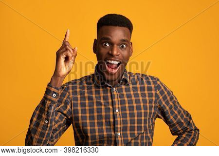 Great Idea. Excited African American Guy Pointing Finger Up And Looking At Camera, Having Inspiratio