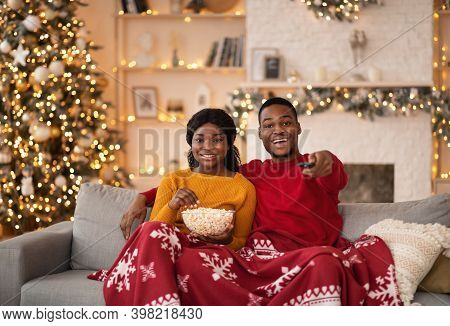 Christmas Eve And Favorite Movie Together At Home. Happy Young African American Couple With Popcorn,