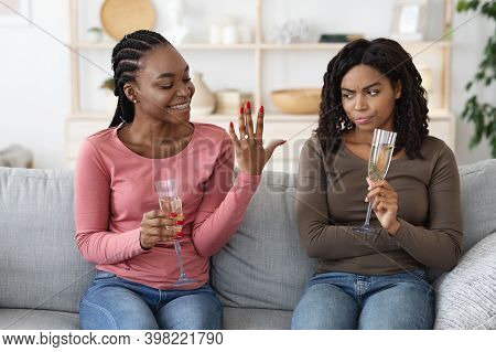 Happy Black Woman Showing Her Upset And Jealous Girlfriend Engagement Ring. Annoyed African American