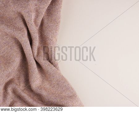 Crumpled Fabric Textured Background, Crumpled Brown Fabric. Random Crumpled Piece Of Clothing Close
