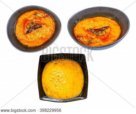 Set Of Dal Tadka (spicy Smooth And Creamy Chowder From Lentils With Curry) In Black Bowl Isolated On