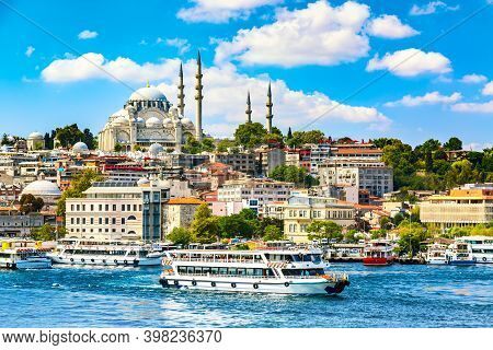 Touristic Sightseeing Ships In Golden Horn Bay Of Istanbul And View On Suleymaniye Mosque With Sulta