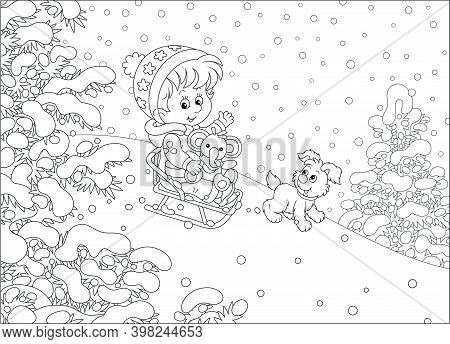 Happy Little Girl And Her Merry Small Puppy Cheerfully Sledding Down A Snow Hill On A Playground In