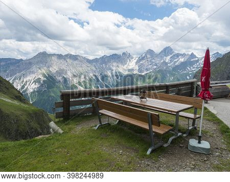 Stubai Valley, Innsbruck-land, Tirol, Austria, July 6, 2020: View Of Table And Bench At Terrace Of I