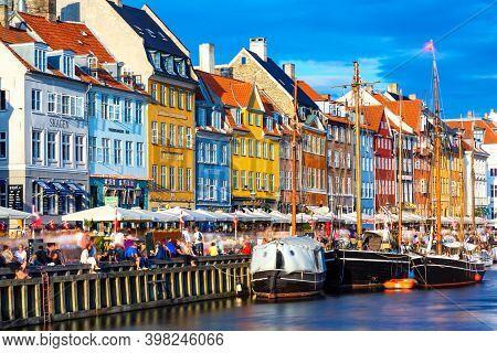 Copenhagen, Denmark - July, 2019: Copenhagen Iconic View. Famous Old Nyhavn Port In The Center Of Co