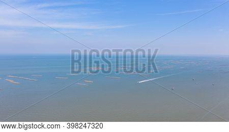 Aerial View Of Aquaculture Nets For Fish Farm In A Lake In Sri Racha, Chonburi, Thailand. Tropical B