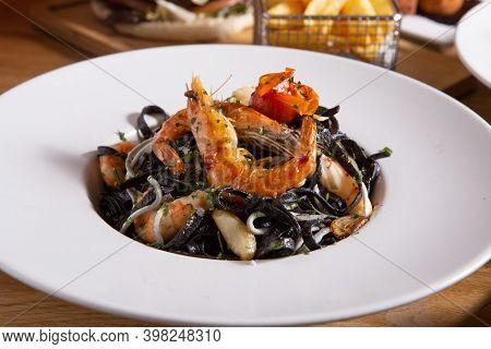 Seafood Black Pasta Spaghetti With Squid And Other Fruit Of The Sea. Spaghetti Ai Frutti Di Mare. It