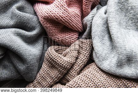 Background With Warm Sweaters. Pile Of Knitted Clothes, Warm Background, Knitwear, Autumn Winter Con