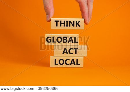 Think Global Act Local Symbol. Wooden Blocks Form The Words 'think Global Act Local' On Beautiful Or