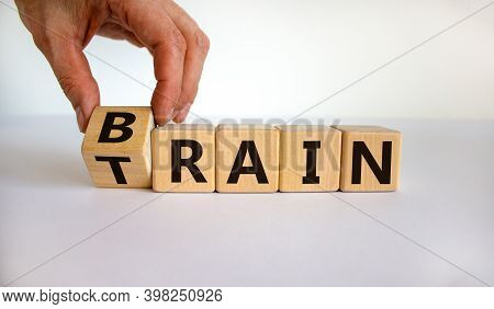 Train Your Brain. Hand Turns A Cube And Changes The Word 'train' To 'brain' On Wooden Cubes. Beautif