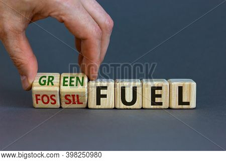 From Fossil To Green Fuel. Male Hand Turns Cubes And Changes The Words 'fossil Fuel' To 'green Fuel'