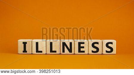 Illness Symbol. Wooden Cubes With Word 'illness'. Beautiful Orange Background. Medical And Illness C