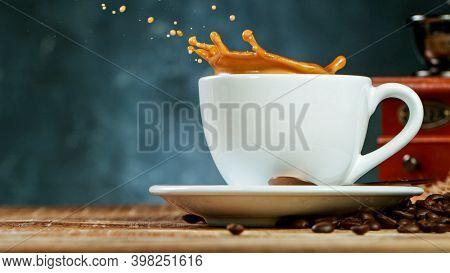 coffee expresso with coffee splash in mug, freeze motion.
