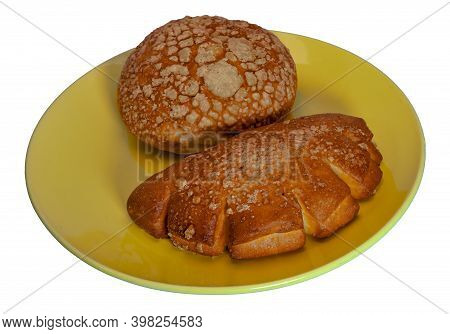 Freshly Baked Bun With A Crispy Crust On A Yellow Platter Isolate On A White Background.