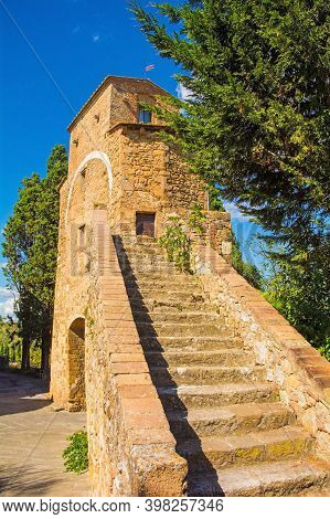 The fifteenth century Porta Cappuccini, one of the gates to the historic medieval village of San Quirico d\'\'Orcia, Siena Province, Tuscany, Italy. Also known as the Gate of the Capuchin Friars