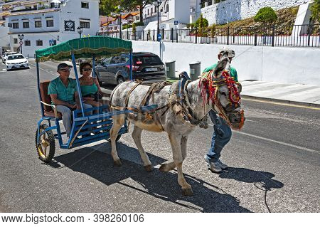 Mijas, Spain - May 22, 2017:  People Take A Ride Around The Lovely Touristy Town Of Mijas In Andalus
