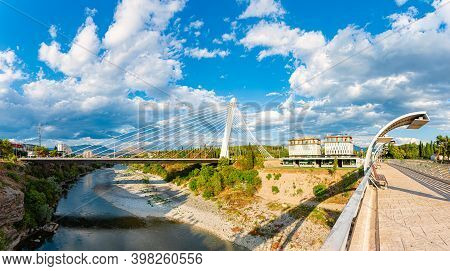 Podgorica, Montenegro - September 7, 2015: Sunny Day With Blue Sky And White Clouds. Modern Bridge I