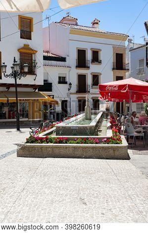 Ojen, Spain - May 22, 2017: View Of The Main Square In The Small Historic Town Ojen Near Marbella
