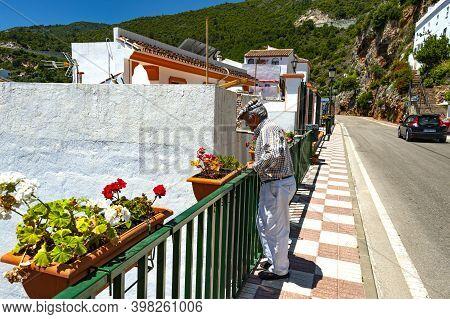 Ojen, Spain - May 22, 2017 : A Senior Gentleman Enjoys His Time Outdoors