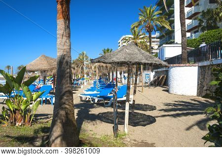 Marbella, Spain - May 21, 2017: Sandy Beach & Cafes In Marbella, A Resort Town In Andalusia, Spain