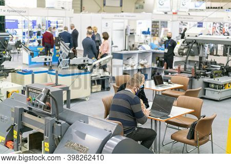 Kiev, Ukraine November 25 2020. Industrial Exhibition During A Pandemic. People At The Exhibition We