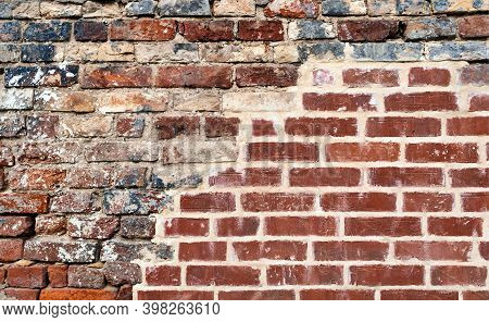 Isolated Brick Wall Red And Black Color. Decay Urban Texture Brick Material. Grungy Rusty Brickwork