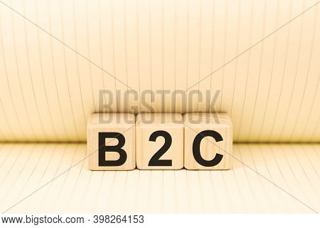 Word B2c Business To Consumer On Wooden Blocks On Paper Background