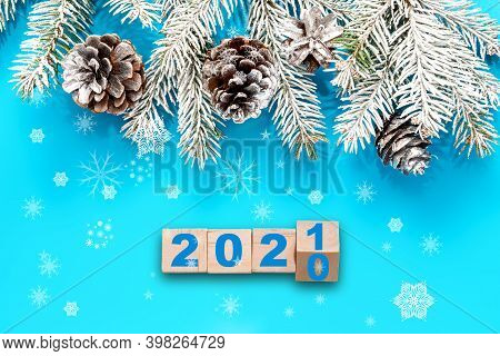Blue Christmas Background, Frame With Fir Branches, And Silver Decorations. The Concept Of Changing