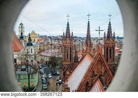 Vilnius, Lithuania - December 28, 2019: Gothic Saint Anne Church And Cityscape Of Vilnius Old Town A