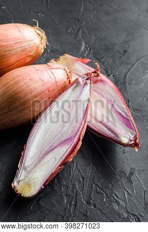 Shallot, Eschalot Or Scallion Raw Ripe Onions Sliced And Halved Black Background Top View Close Up