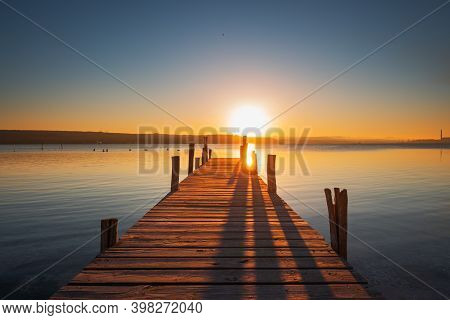 Sunset Over The Lake And Wooden Pier, Hdr Image.
