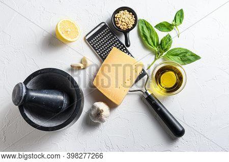 Pesto Alla Genovese , Green Basil Pesto Sauce Ingredients With Ceramic Mortar Top View Or Flat Lay O