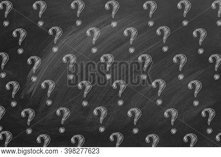 Question Marks In Chalk On A Blackboard. Ask For Help. Faq Concept. Asking Questions. 2d Illustratio