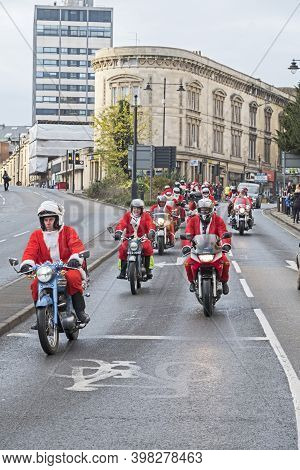 Bristol, Uk - December 2, 2017: Motorcyclists Dressed As Santa Claus Ride Through The City Centre To