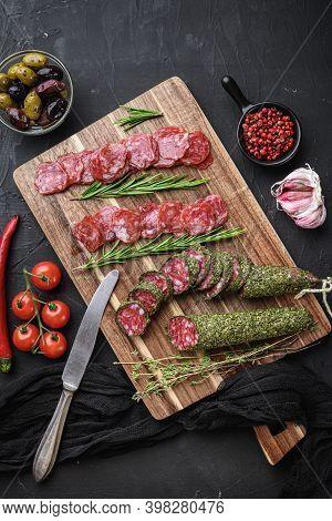 Spanish Fuet Salami Sausage Slices On Balck Background, Top View