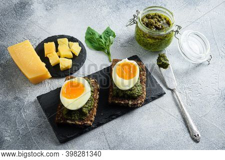 Homemade Eggs Panini Bread With Green Basil Pesto Silver Spoon On Italian Breakfast With Ingredients