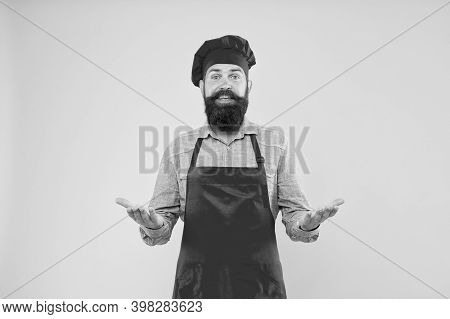Food In Your Budget. Confident Bearded Happy Chef Red Uniform. Male Chef In Red Uniform. Mature Hips