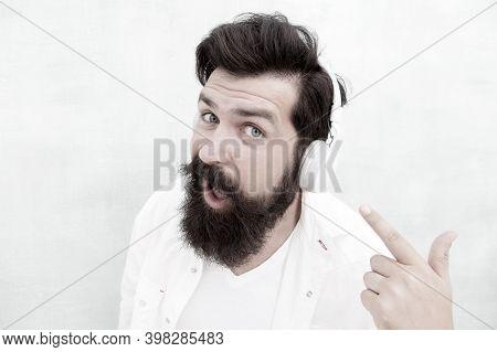 Modern Wireless Headphones. Electronic Dance Music Tracks. Instrumental Music. Bearded Man Headphone