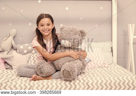 Happiness Lives Here. Happy Child Smile On Bed. Small Girl Cuddle Teddy Bear. Happiness With Friend.