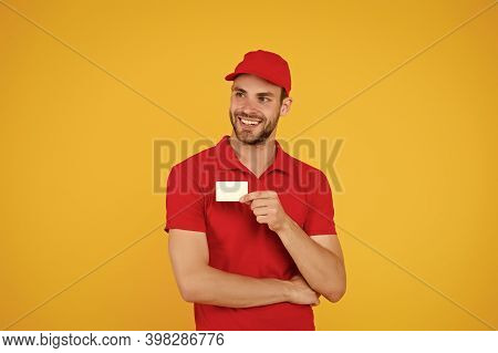 Home Delivery Using Credit Card As Payment. Pizza Delivery Man Hold Business Card. Man Pay Deliverer